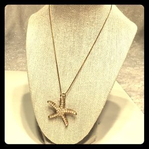 Pearlized starfish necklace gold chain